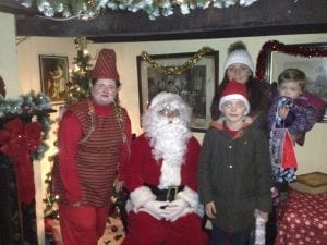 Santa with his elf and visitors